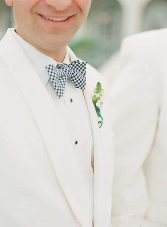 traje de novio blanco moño casual fistol